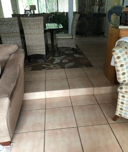 Step down from living area into family room