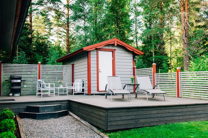 The porch connects the house with the small cabin with beds for two.