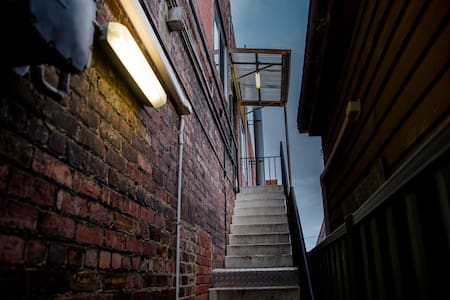 Well lit Stairway with a side rail for safety and comfort