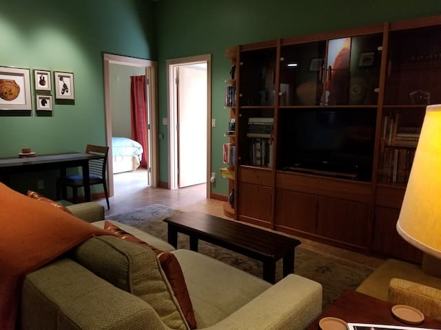 The living/dining area is comfy and homey. There are lots of books, board games, coloring books and basic cable tv.
