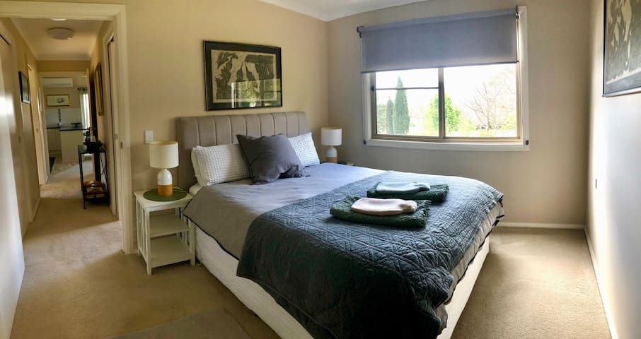 Large main bedroom with walk-in wardrobe and plenty of storage