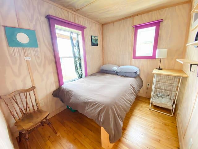 Bedroom: full size bed, drawers, hooks, shelves