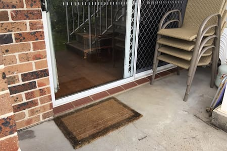 Wide sliding door with shallow threshold.