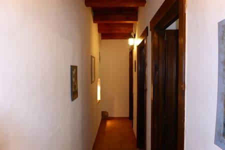long corridor leading to bathroom, utility room and main bedroom.