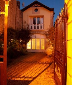 Fairy lights, night-time motion-activated security light, street lights just in front of house as well.