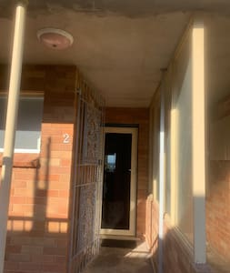Entrance to property ground floor with external light