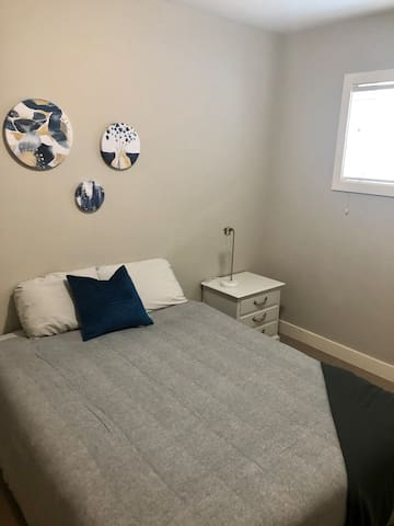 2nd bedroom, queen size bed. Large closet and bright window!