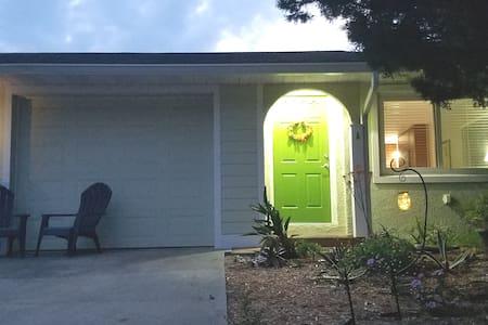 A motion sensitive light illuminates the entryway.