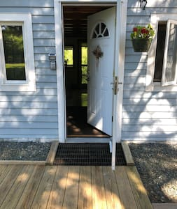 Front entryway has no steps to enter. A boardwalk and deck surround most of the cottage.
