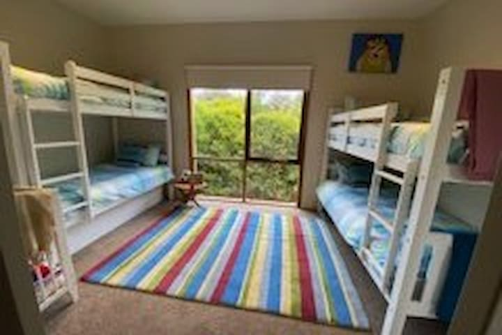 3rd bedroom with views over the backgarden. Room to sleep 5 kids with the trundle plus a full sized cot which can be moved into any room of the house if required.  BIR and plenty of space