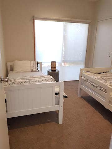 Fourth bedroom with BIR and 2 single beds