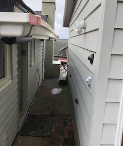 Motion detection lighting of breezeway to from door