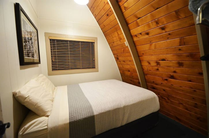 Queen sized bed guest room #1
