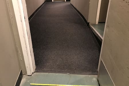 Access door from the parking garage is 32 inches/82cm wide with an incline.