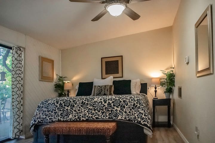 Guest bedroom with king bed and walk-out to back yard.