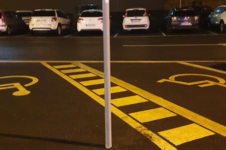 2 places parking in front of the building