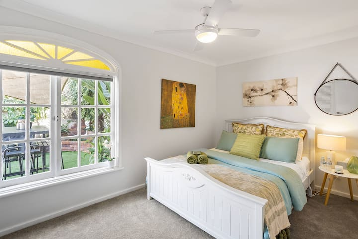 Queen size bedroom 2. Looks out to the quaint courtyard from the gorgeous french windows