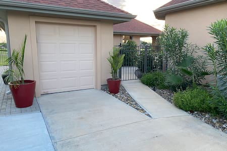Parking area and gate to enter the backyard.