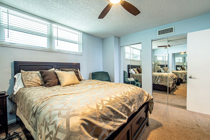 Large second bedroom with queen bed, large dresser, and lots of closet space.