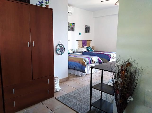 The twin bedroom features a computer desk for your laptop.  Our wifi is excellent- we use Google mesh for distribution and a fiber/microwave ISP