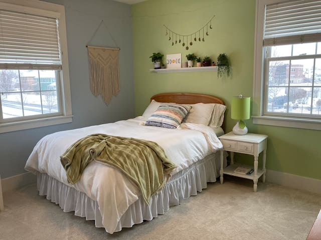 Queen bed with shared bath