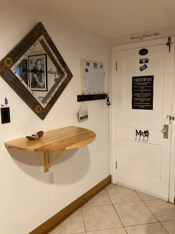 Inside Cats' Den: Mirror, coat rack & key rack, and the wall-mounted table. Meow!