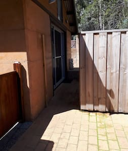 Flat entrance from driveway. Gateway is greater than 32 inches wide.