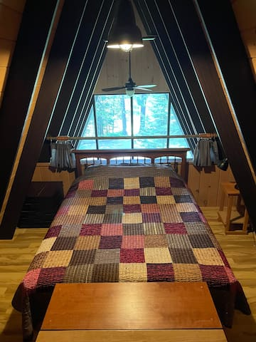 Upper loft bedroom with queen size bed (pillows and linens provided).