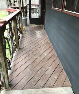 Deck leads to door.