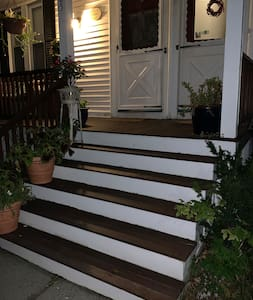 Front porch steps are illuminated by street lights and the front doors have a porch light.