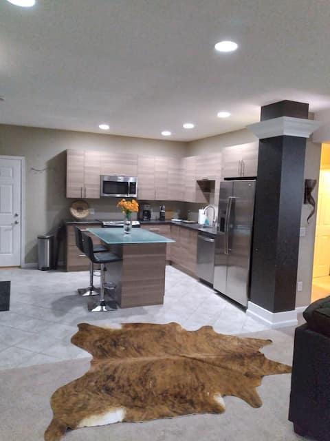 "Beautiful Modern Lower Level Suite   70"" smart TV."