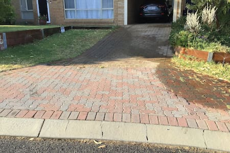 There is a sloped curb from the street to the  paved driveway