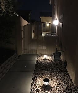 The side entrance is well lit at night with landscape lighting as well as wall lighting.