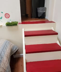 Five step stair from the bedroom to the kitchen and bathroom