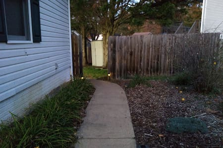 Pathway to the right of the light on the garage is flanked by solar pathway lights. Generally, the lights from the two big spotlights prevent their illumination.