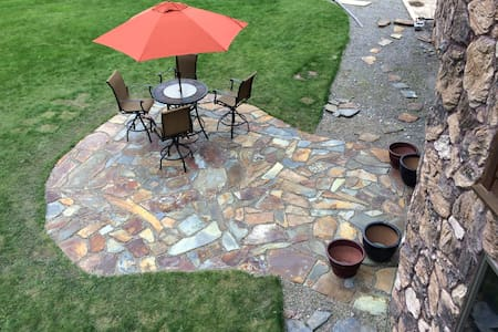 Hard packed gravel leading to a flat and level patio