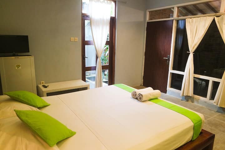 A rustic room Bromo at Atmos Co-Living