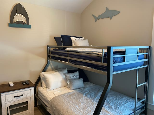 """Kids Room, one of two beds, Twin on top and Full on bottom,  other bed is a bunk with two twins, room has a dresser, closet and 42"""" TV"""