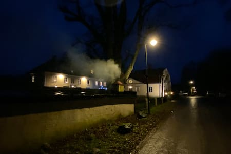 There is streetlights and facadelights outside the house