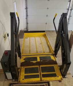Wheelchair lift in garage to landing with access immediately in to the estate.