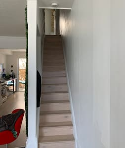Stairs to 2nd floor where the guest room is from the main floor.