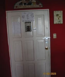 this is the main door to get into the house.  It is 32 inches or a little more.  No steps, just walk into the house.
