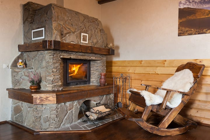 Apartment with a fireplace on the top of a hill