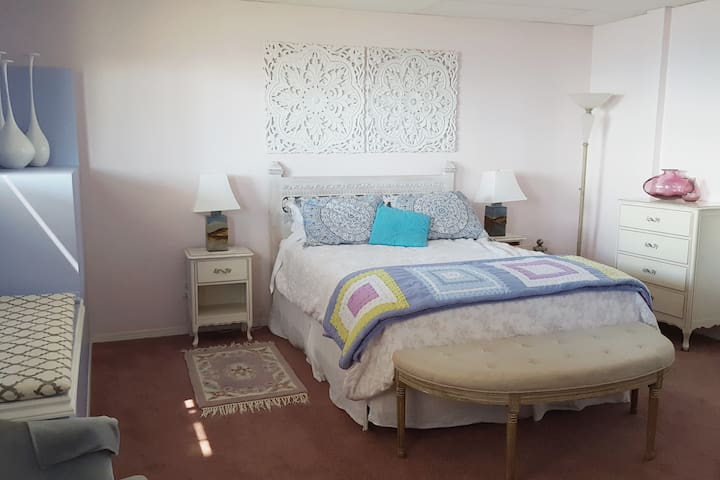 Tastefully decorated Master Bedroom with an upscale Bohemian flare and a palette to match the surrounding desertscape. High end chiropractic bed, 3 sets of drawers, TV, and natural fibre linens, pottery lamps all in a spacious bedroom
