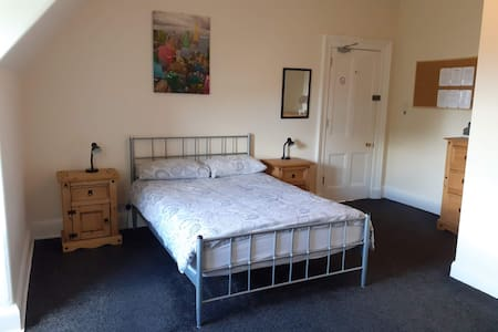 Large bedroom with en-suite in period property