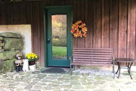 Stone patio to entry door to apartment.