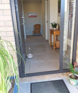 There is a very small step of 16 mm to enter inside from the front path entrance