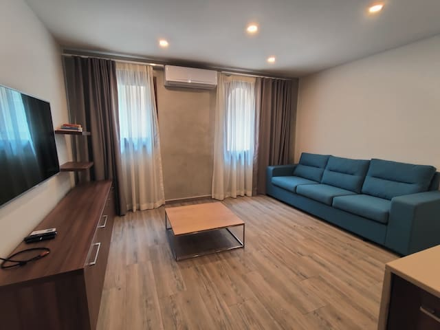 Old Theatre Apartments in Rabat -  Large Living Room with A/C and comfortable large sofa.
