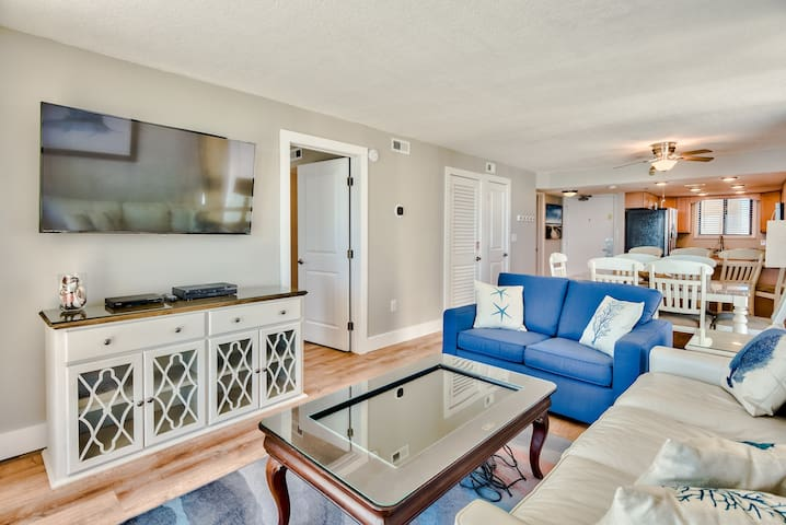 Living room with smart coffee table. Ivory leather sofa is a queen sleeper.