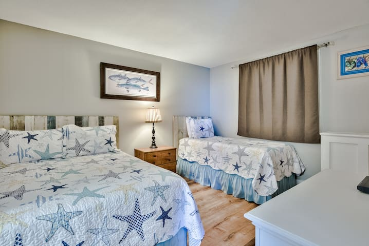 Guest bedroom with a full size and a twin size bed